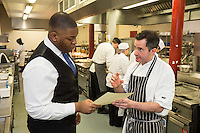 Student Callum Watson discusses the menu with Mark Anderson of the Ruddington Arms