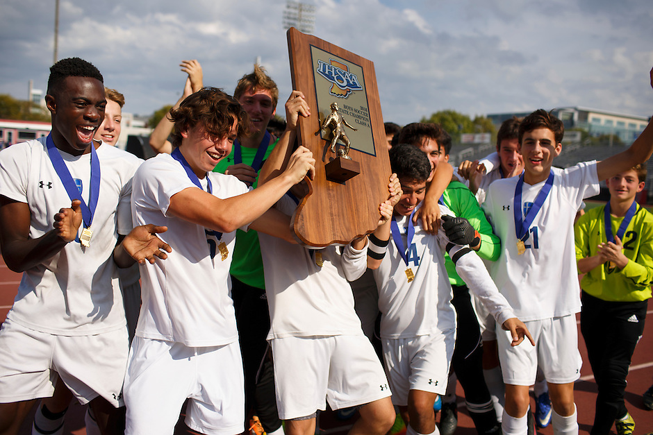 Mishawaka Marian players celebrate after a 4-0 win against Providence in the IHSAA Class A Boys Soccer State Championship Game on Saturday, Oct. 29, 2016, at Carroll Stadium in Indianapolis. Special to the Tribune/JAMES BROSHER