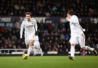 Barclays Premier League, West Ham V Swansea, 02/02/2013<br /> Pictured: (L-R) Michu, Pablo Hernandez.<br /> Picture by: Ben Wyeth / Athena