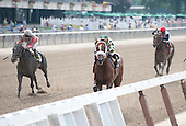 Mucho Macho Man pulls away from Hymn Book, left, and To Honor And Serve.