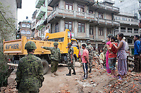 The rescue workers from Nepalese Army and Canadian Army special force clean the rubble. Shanku, near Kathmandu, Nepal. May 13, 2015