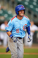 Tennessee Smokies outfielder Albert Almora (6) runs to first during a game against the Montgomery Biscuits on May 25, 2015 at Riverwalk Stadium in Montgomery, Alabama.  Tennessee defeated Montgomery 6-3 as the game was called after eight innings due to rain.  (Mike Janes/Four Seam Images)