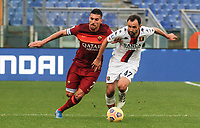 Roma's Lorenzo Pellegrini, left, and Genoa's Milan Badelj fight for the ball during the Italian Serie A Football match between Roma and Genoa at Rome's Olympic stadium, March 7, 2021.<br /> UPDATE IMAGES PRESS/Riccardo De Luca
