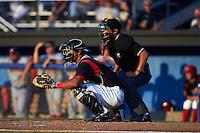 Batavia Muckdogs catcher Brad Haynal (23) and umpire David Martinez during a game against the Auburn Doubledays July 10, 2015 at Dwyer Stadium in Batavia, New York.  Auburn defeated Batavia 13-1.  (Mike Janes/Four Seam Images)