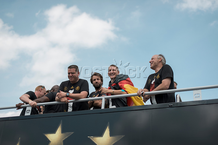 Berlin, 15.07.2014. Die Ankunft der Deutschen Fussballnationalmannschaft in Berlin.<br /> <br /> English: Berlin Welcomes the World champions, German soccer national team wins FiFA World Cup in Brazil, welcome party in Berlin, Germany, June 15, 2014. Arrival of the champions on an open truck, Bastian Schweinsteiger wearing a German flag
