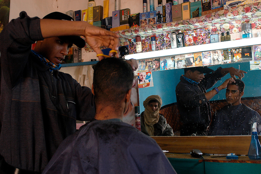 A hairdresser of Aaiun is pictured on December 12, 2003. Saharawi people have been living at the refugee camps of the Algerian desert named Hamada, or desert of the deserts, for more than 30 years now. Saharawi people have suffered the consecuences of European colonialism and the war against occupation by Moroccan forces. Polisario and Moroccan Army are in conflict since 1975 when Hassan II, Moroccan King in 1975, sent more than 250.000 civilians and soldiers to colonize the Western Sahara when Spain left the country. Since 1991 they are in a peace process without any outcome so far. (Ander Gillenea / Bostok Photo)