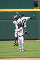 FCL Braves outfielders Brandol Mezquita (23), Kadon Morton (2), and Jose Palma (9) celebrate after a game against the FCL Orioles Orange on July 22, 2021 at the CoolToday Park in North Port, Florida.  (Mike Janes/Four Seam Images)