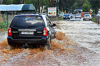 Pictured: A car travels through a flooded road in Messini, near the town of Kalamata, Messinia, Greece. Wednesday 07 September 2016<br /> Re: Severe flash flooding has affected parts of Messinia County in southern Greece.