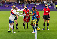 ORLANDO, FL - JANUARY 18: Becky Sauerbrunn #4 of the USWNT exchanges banners with Caralina Usme #11 of the Colombia before a game between Colombia and USWNT at Exploria Stadium on January 18, 2021 in Orlando, Florida.