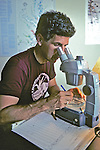 Michael Erwin Looking At Samples Microscope