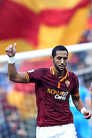 ROMA, Italy: December 22, 2013: As Roma beats Catania 4-0 during the Serie A match played in the Olimpico Stadium. In the photo Mehdi Benatia celebrating the goal scored of 1-0