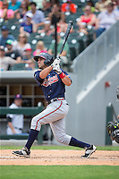 Jose Peraza (1) of the Gwinnett Braves follows through on his swing against the Charlotte Knights at BB&T BallPark on July 3, 2015 in Charlotte, North Carolina.  The Braves defeated the Knights 11-4 in game one of a day-night double header.  (Brian Westerholt/Four Seam Images)