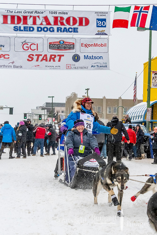 Martin Buser and team leave the ceremonial start line with an Iditarider and handler at 4th Avenue and D street in downtown Anchorage, Alaska on Saturday March 7th during the 2020 Iditarod race. Photo copyright by Cathy Hart Photography.com