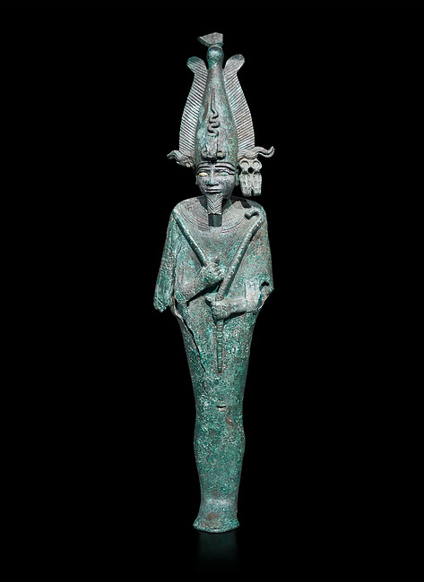 Ancient Egyptian bronze statue of Osiris, Ptolomaic Period, (722-30 BC). Egyptian Museum, Turin. Black background,. Old fundCat 39.