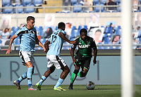 Football, Serie A: S.S. Lazio - Sassuolo, Olympic stadium, Rome, July 11, 2020. <br /> Sassuolo's Jeremie Boga (r) in action with Lazio's Bastos (c) and Sergej Milinkovic-Savic (l) during the Italian Serie A football match between S.S. Lazio and Sassuolo at Rome's Olympic stadium, Rome, on July 11, 2020. <br /> UPDATE IMAGES PRESS/Isabella Bonotto
