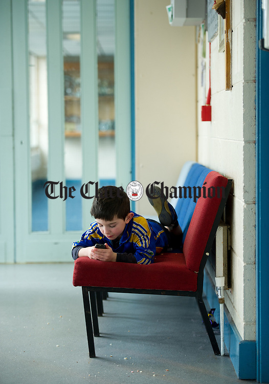 Muiris Quinn having a break at the Community Games Draughts county finals in Tulla. Photograph by John Kelly.