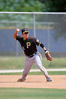 Pittsburgh Pirates third baseman Jung Ho Kang (15) throws to second base during practice before a Florida Instructional League game against the Toronto Blue Jays on September 20, 2018 at the Englebert Complex in Dunedin, Florida.  Kang is on rehab assignment after having surgery on his left wrist to remove cartilage.  (Mike Janes/Four Seam Images)