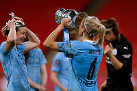 1st November 2020; Wembley Stadium, London, England; Womens FA Cup Final Football, Everton Womens versus Manchester City Womens; Steph Houghton of Manchester City Women drinking Champagne from the Womens FA Cup Final Trophy with Janine Beckie of Manchester City Women putting the Womens FA Cup Final Trophy lid on her head