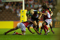 Joe Marler of Harlequins is tackled by Matt Corker (left) and Hudson Tonga'uiha of London Welsh during the Aviva Premiership match between Harlequins and London Welsh at the Twickenham Stoop on Friday 7th September 2012 (Photo by Rob Munro)