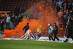 Dundee Utd fans celebrate with flares and ticker tape