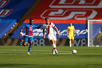 12th September 2020; Selhurst Park, London, England; English Premier League Football, Crystal Palace versus Southampton; Jordan Ayew of Crystal Palace challenges Jannik Vestergaard of Southampton
