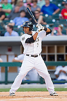 Micah Johnson (3) of the Charlotte Knights at bat against the Norfolk Tides at BB&T Ballpark on May 21, 2014 in Charlotte, North Carolina.  The Tides defeated the Knights 10-3.  (Brian Westerholt/Four Seam Images)