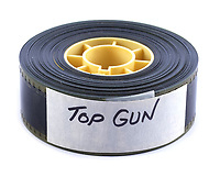 BNPS.co.uk (01202) 558833. <br /> Pic: PropStore/BNPS<br /> <br /> Pictured: This 35mm film trailer reel for Top Gun is included in the sale. <br /> <br /> Costume props and behind-the-scenes photos from the classic Tom Cruise movie Top Gun are coming up for sale.<br /> <br /> The archive includes the white vest worn by Goose, the partner of Tom Cruise's character Pete 'Maverick' Mitchell, during the famous beach volleyball scene. <br /> <br /> There is also the flight suit worn by Maverick's Top Gun rival, Tom 'Iceman' Kazansky, played by Val Kilmer in the 1986 film.