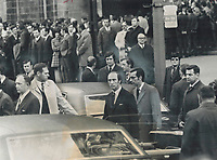 Prime minister Pierre Trudeau and Quebec Premier Robert Bourassa; surrounded by plainclothes security men; leave Notre Dame Church in Montreal after funeral services for Pierre Laporte. Trudeau flew from Ottawa to Montreal by helicopter; escorted by other helicopters; and landed at city hall; just two blocks form the church. Security measures were strict; prompted by police concern that the Front de Liberation du Quebec might attack official mourners.<br /> <br /> 1970<br /> <br /> PHOTO :  Doug Griffin - Toronto Star Archives - AQP