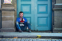 Saturday  17 December 2016<br /> Pictured: A man Sits on the street on Swansea's Wind Street <br /> Re: Swansea City Centre and the notorious Wind street, often nicknamed 'Wine Street' is packed full of Christmas jumpers and glitzy dresses as thousands head to office dos across the UK in the biggest party night of the year.