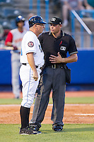Hudson Valley Renegades manager Tim Parenton (31) questions a call with home plate umpire Tyler Olson during the game against the Brooklyn Cyclones at Dutchess Stadium on June 18, 2014 in Wappingers Falls, New York.  The Cyclones defeated the Renegades 4-3 in 10 innings.  (Brian Westerholt/Four Seam Images)