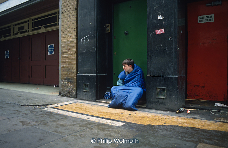 A homeless young man begs in central London