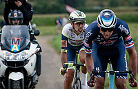 Taco van der Hoorn (NED/Intermarché - Wanty - Gobert Matériaux) wondering what to do with Mathieu van der Poel (NED/Alpecin-Fenix) being his breakaway partner in the race finale<br /> <br /> Antwerp Port Epic / Sels Trophy 2021 (BEL)<br /> One day race from Antwerp to Antwerp (183km)<br /> <br /> The APC stands qualified as a 'road race', but with 36km of gravel and 28km of cobbled sections in and around the Port of Antwerp (BEL) this race occupies a unique spot in the Belgian race scene.<br /> <br /> ©kramon