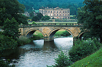 Bridge and front facade of Chatsworth from the bridge across the River Derwent. manor, architecture, scenic, pastoral landscape, countryside, estate house. England Great Britain Derbyshire.