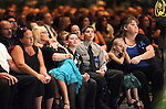Family members watch a slide show during a memorial service for Carson City Sheriff's Deputy Carl Howell at the Reno Events Center in Reno, Nev., on Thursday, Aug. 20, 2015. Howell was shot and killed early Saturday morning after responding to a domestic violence call. (Cathleen Allison/Las Vegas Review-Journal)