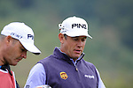 ISPS Handa Wales Open Golf day two :  Lee Westwood chats to his caddie as he walks off the 11th tee at the Celtic Manor course in Newport, UK this afternoon.