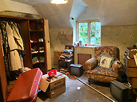 BNPS.co.uk (01202 558833)<br /> Pic: Symonds&Sampson/BNPS<br /> <br /> Pictured: An upstairs.<br /> <br /> An abandoned cottage that is covered by undergrowth and looks like something out of a horror film has sold for a whopping £430,000.<br /> <br /> The derelict property, called Grasshopper Cottage, had a valuation of £275,000 before it went up for sale at auction.<br /> <br /> But due to the current state of the property market where demand far outstrips supply, interest and bidding in the 150-year-old cottage took off.