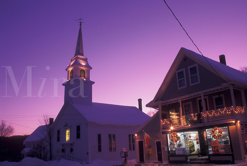 Vermont, VT, Country market and church in the scenic village of East Corinth in the evening decorated for Christmas in the winter.