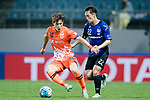 Gamba Osaka Defender Oh Jaesuk (R) fights for the ball with Jeju United Midfielder Lee Changmin (L) during the AFC Champions League 2017 Group H match Between Jeju United FC (KOR) vs Gamba Osaka (JPN) at the Jeju World Cup Stadium on 09 May 2017 in Jeju, South Korea. Photo by Marcio Rodrigo Machado / Power Sport Images