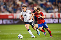United States (USA) midfielder Carli Lloyd (10) is chased by Korea Republic (KOR) midfielder Shin Jiyoung (19). The women's national team of the United States defeated the Korea Republic 5-0 during an international friendly at Red Bull Arena in Harrison, NJ, on June 20, 2013.