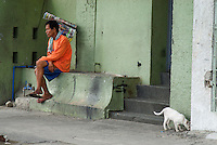 A street vendor having a rest view from the car window Manila, Philippines