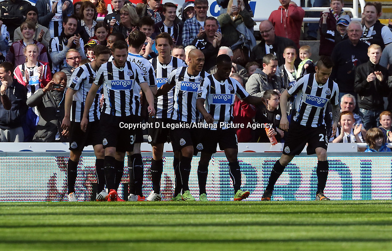 Pictured: Shola Ameobi of Newcastle is mobbed by team mates as he celebrates his opening goal. Saturday 19 April 2014<br /> Re: Barclay's Premier League, Newcastle United v Swansea City FC at St James Park, Newcastle, UK.