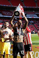 29th May 2021; Wembley Stadium, London, England; English Football League Championship Football, Playoff Final, Brentford FC versus Swansea City; Ivan Toney of Brentford lifts the Sky Bet EFL Championship Plays-off Trophy after they won 2-0 and promoted to the premier league