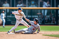 Michigan Wolverines shortstop Jack Blomgren (2) attempts to turn a double play against the Texas Tech Red Raiders as baserunner Braxton Fulford (26) slides into second during in the NCAA College World Series on June 21, 2019 at TD Ameritrade Park in Omaha, Nebraska. Michigan defeated Texas Tech 15-3 and will play in the CWS Finals. (Andrew Woolley/Four Seam Images)