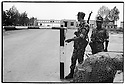 Uzbekistan - Termez - Soldiers standing at the checkpoint before the Bridge of Friendship that separates Uzbekistan from Afghanistan.