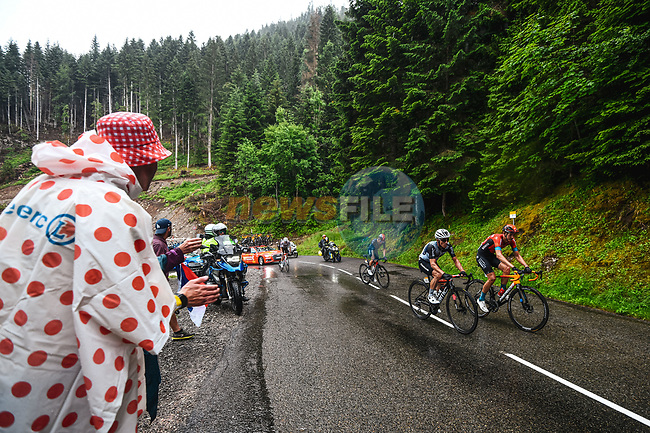 Dylan Teuns (BEL) Bahrain Victorious and Sergio Henao Montoya (COL) Qhubeka-NextHash climb during Stage 8 of the 2021 Tour de France, running 150.8km from Oyonnax to Le Grand-Bornand, France. 3rd July 2021.  <br /> Picture: A.S.O./Charly Lopez | Cyclefile<br /> <br /> All photos usage must carry mandatory copyright credit (© Cyclefile | A.S.O./Charly Lopez)