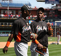 Miami Marlins shortstop Jose Reyes #7 (right) talks with Hanley Ramirez #2 during batting practice before a game against the Philadelphia Phillies at Citizens Bank Park on April 9, 2012 in Philadelphia, Pennsylvania.  Miami defeated Philadelphia 6-2.  (Mike Janes/Four Seam Images)