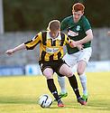 East Fife's Alan Cook holds off Hibs' Michael Richardson.