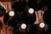 Bottles of Cornas wine seen from above with corks stamped with the vintage year 2001.  Domaine Eric et Joel Joël Durand, Ardeche, Ardèche, France, Europe