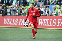 SEATTLE, WA - NOVEMBER 10: Nicolas Benezet #7 of Toronto FC runs with the ball during a game between Toronto FC and Seattle Sounders FC at CenturyLink Field on November 10, 2019 in Seattle, Washington.