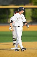 Evan Stephens (5) of the Wake Forest Demon Deacons takes his lead off of second base against the Maryland Terrapins at Wake Forest Baseball Park on April 4, 2014 in Winston-Salem, North Carolina.  The Demon Deacons defeated the Terrapins 6-4.  (Brian Westerholt/Four Seam Images)
